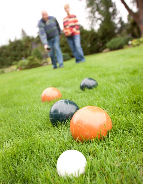 Elderly couple playing Bocce ball