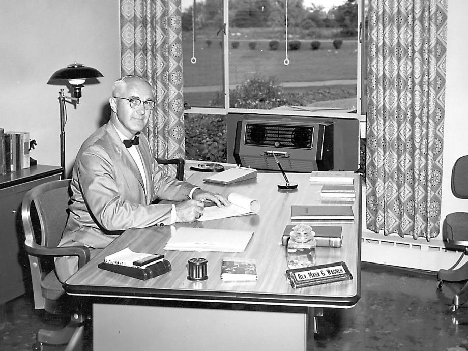 Rev. Mark G Wagner in his office, seated at desk