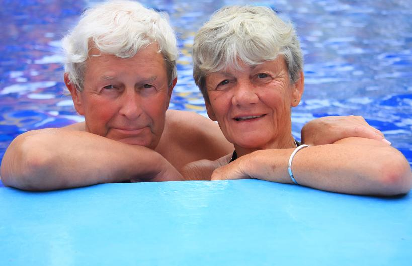 Elderly couple in swimming pool